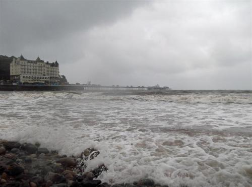 Llandudno Pier and the Grand Hotel in stormy weather